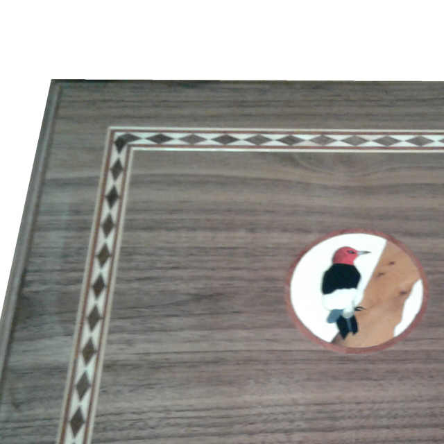 Box with marquetry logo