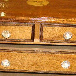 Restored chest with marquetry logo