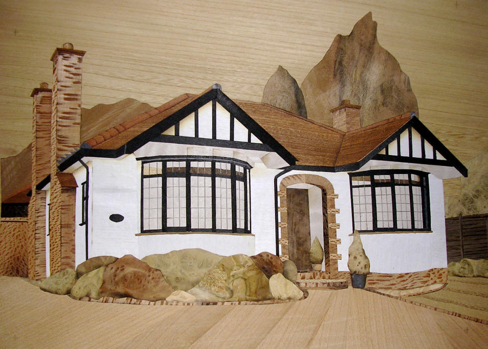 Marquetry picture of house