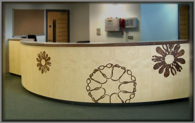 large reception desk with marquetry design