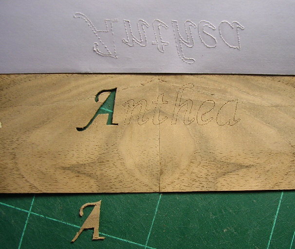 Veneer with design cut out