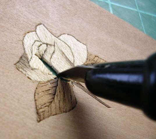 close-up of hands working on marquetry jewellery