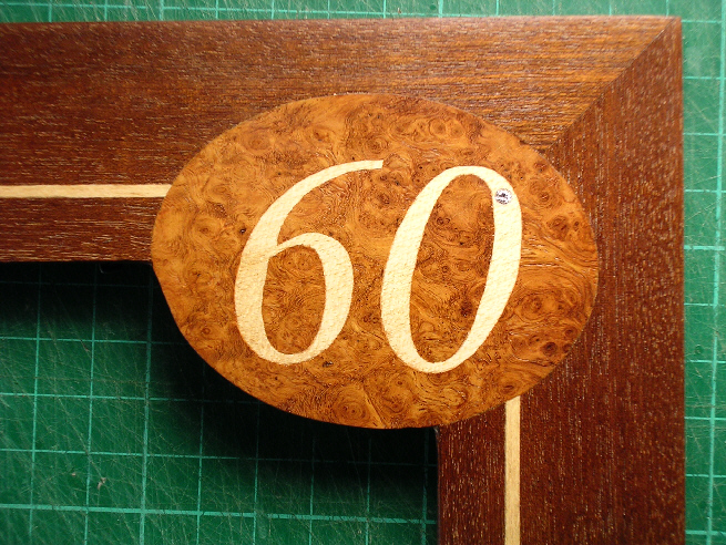 part of photgraph frame with numerals '60'